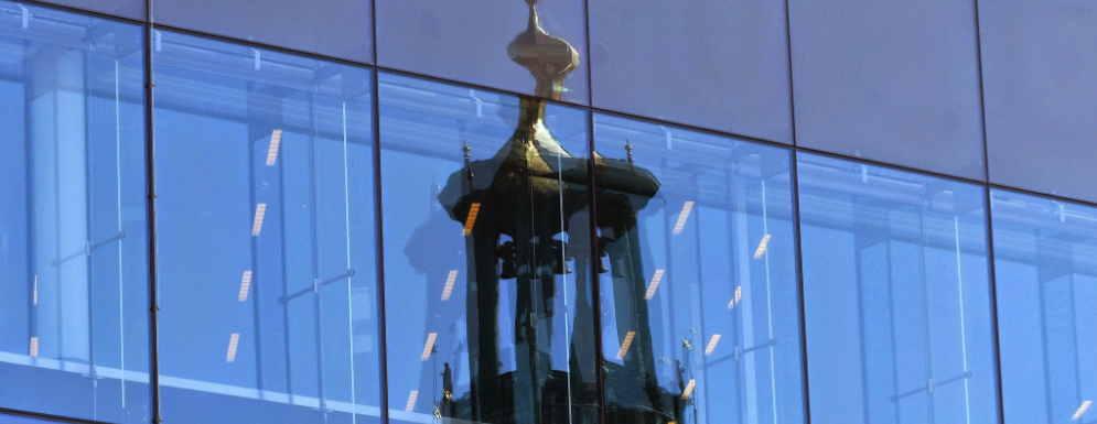 Church reflected in glass